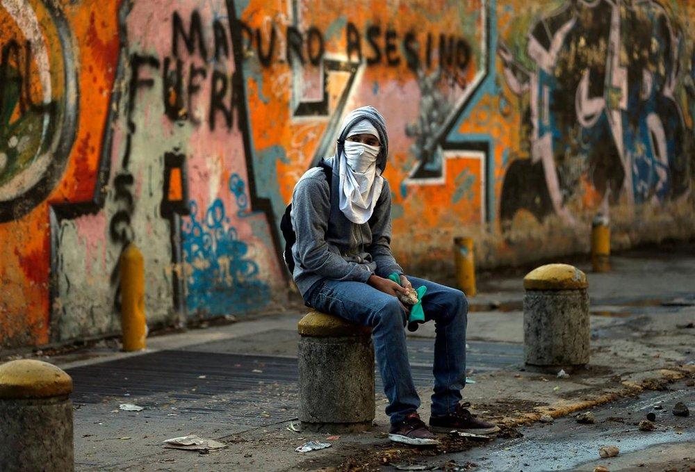 140306-gp-venezuela-story_e09775f8d10f2e5c3b43fbe2e0c12c93.nbcnews-ux-2880-1000.jpg