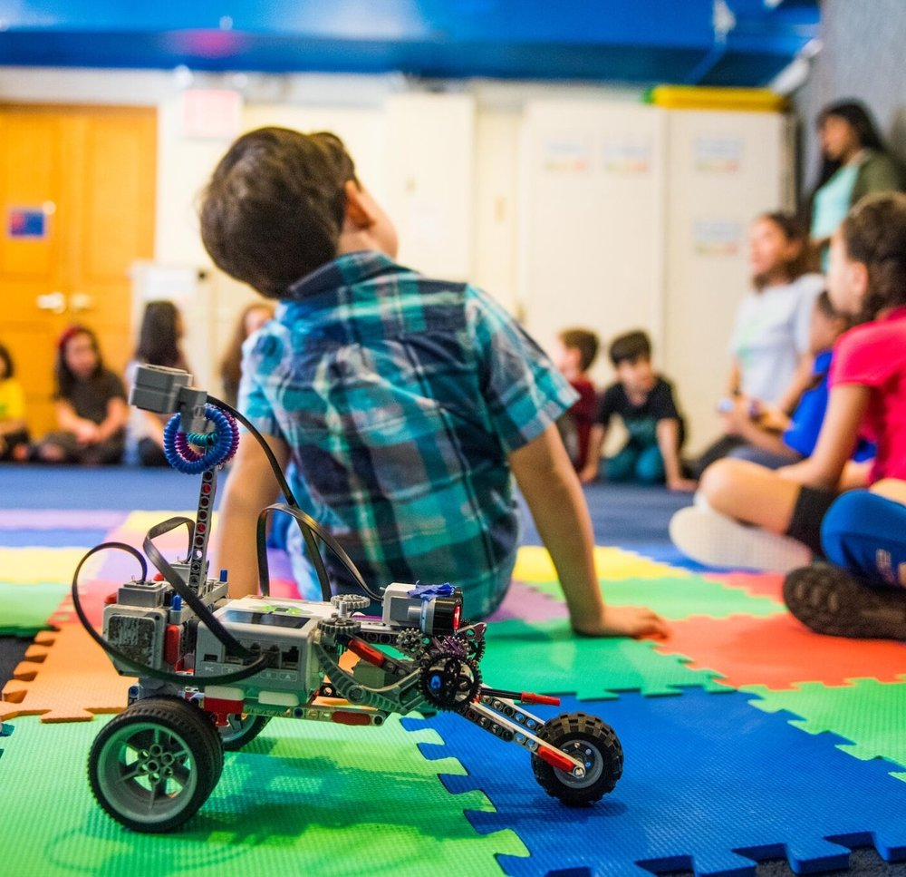 "WHAT PARENTS SAY - ""It is every parent's dream when your child comes home and says, ""I loved it, I want to go back to Robofun.""- Robofun Parent"