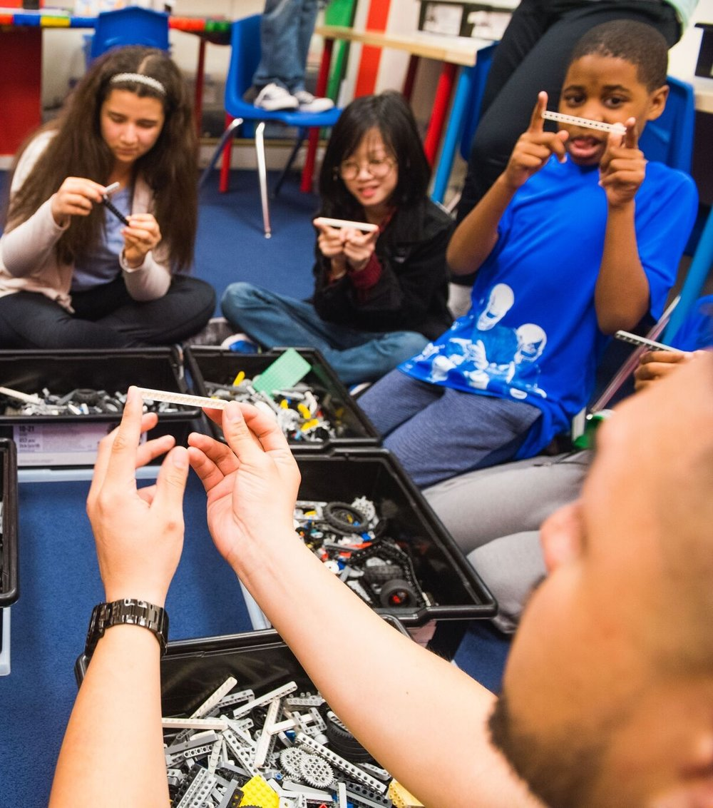 """WHAT PARENTS SAY - """"What I find unique and impressive about Robofun is their inclusion philosophy; everyone is welcomed and every child's learning style and behavior are carefully attended to. Robofun is structured and very friendly and they literally unlocked my child's creativity. Watching his level of pride when he comes home and can tell me about what he's constructed and how it works is very fulfilling. There are areas where Henry has trouble"""
