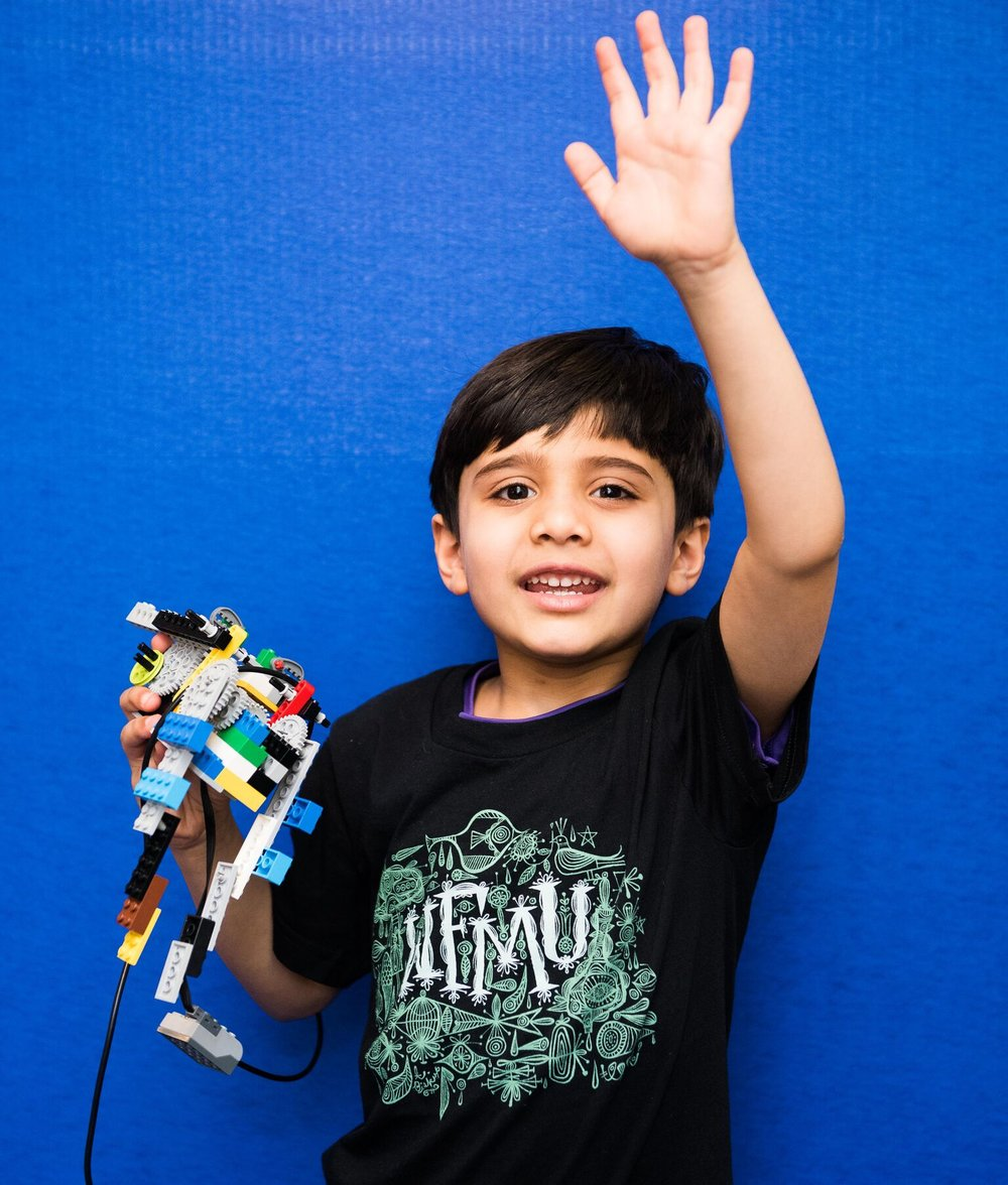 """WHAT PARENTS SAY - """"What I find unique and impressive about Robofun is their inclusion philosophy; everyone is welcomed and every child's learning style and behavior are carefully attended to. Robofun is structured and very friendly, and they literally unlocked my child's creativity. Watching his level of pride when he comes home and can tell me about what he's constructed and how it works is very fulfilling. There are areas where Henry has trouble"""