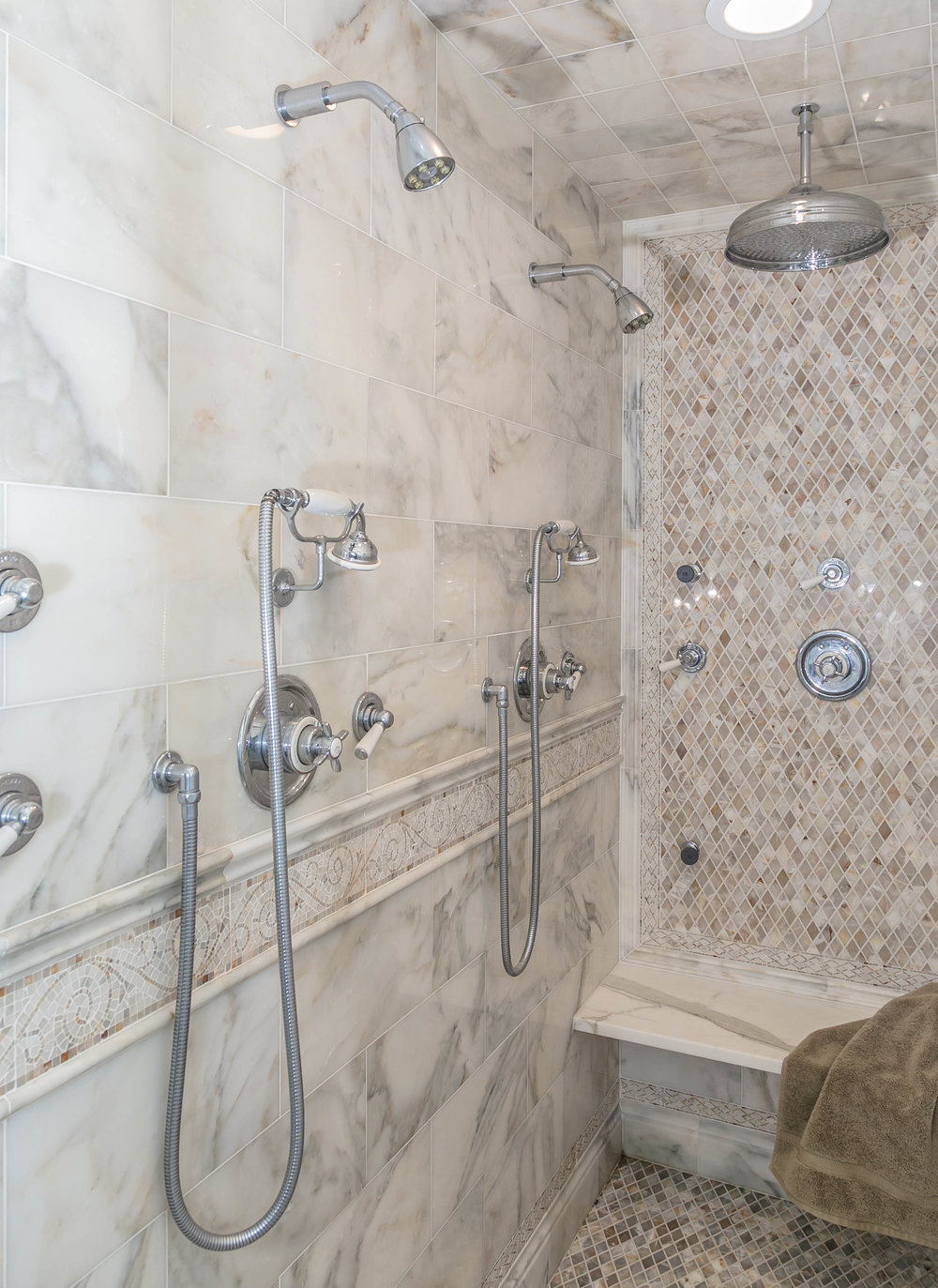 Shower with multiple shower heads and and a seat