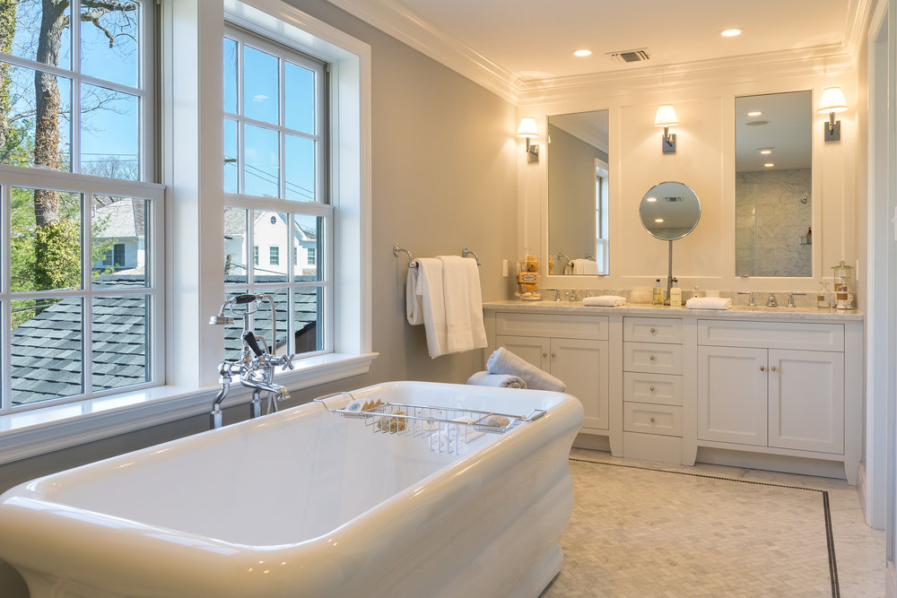 Large bathroom with ceramic plunge tub and double sinks