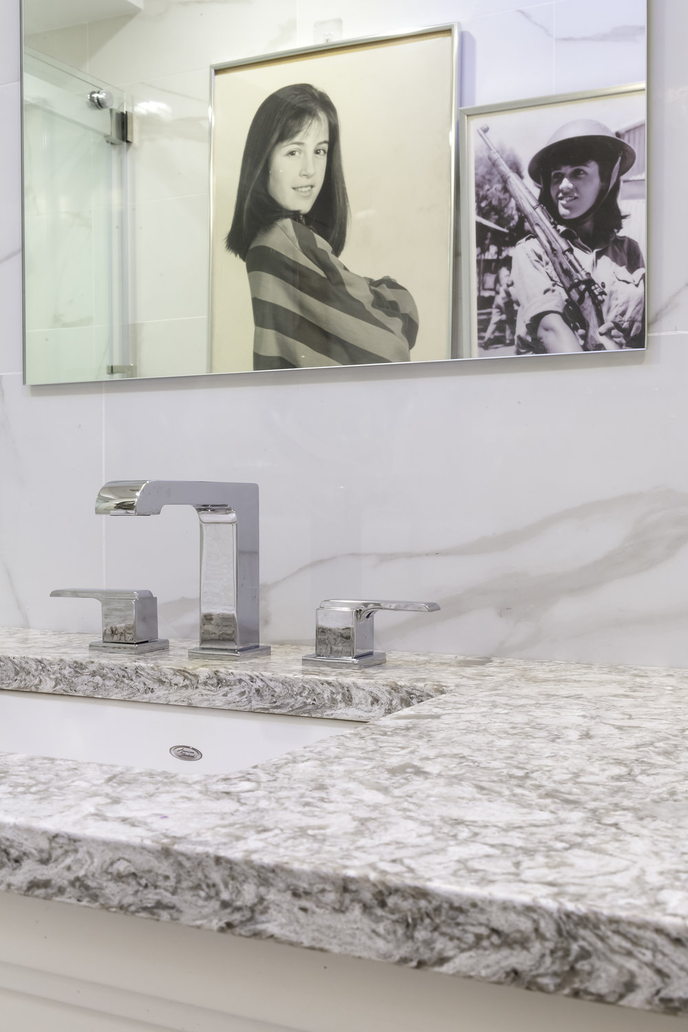 Marble counter with sink and square style faucet