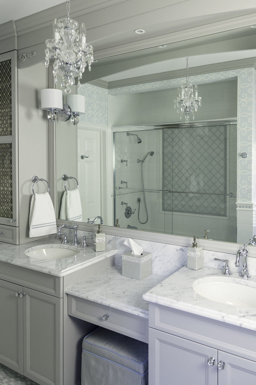 Bright bathroom with double sink and full wall mirror