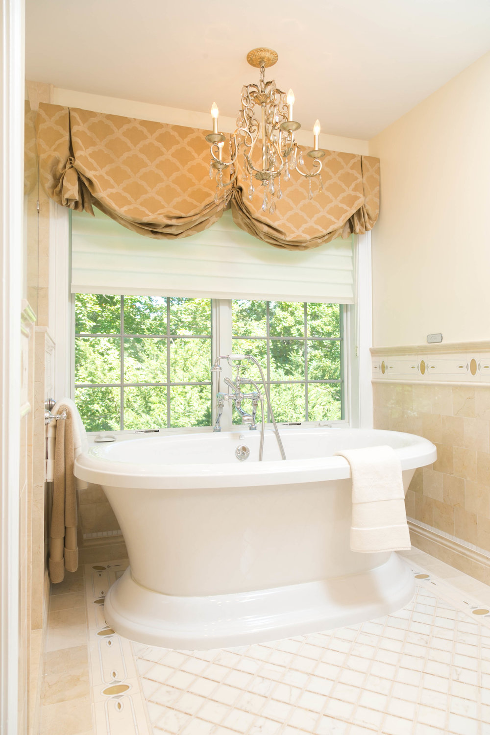 Luxurious bathroom with round plunge bath and custom window coverings