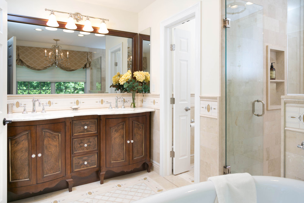 Luxurious bathroom with double sink and full wall mirror above