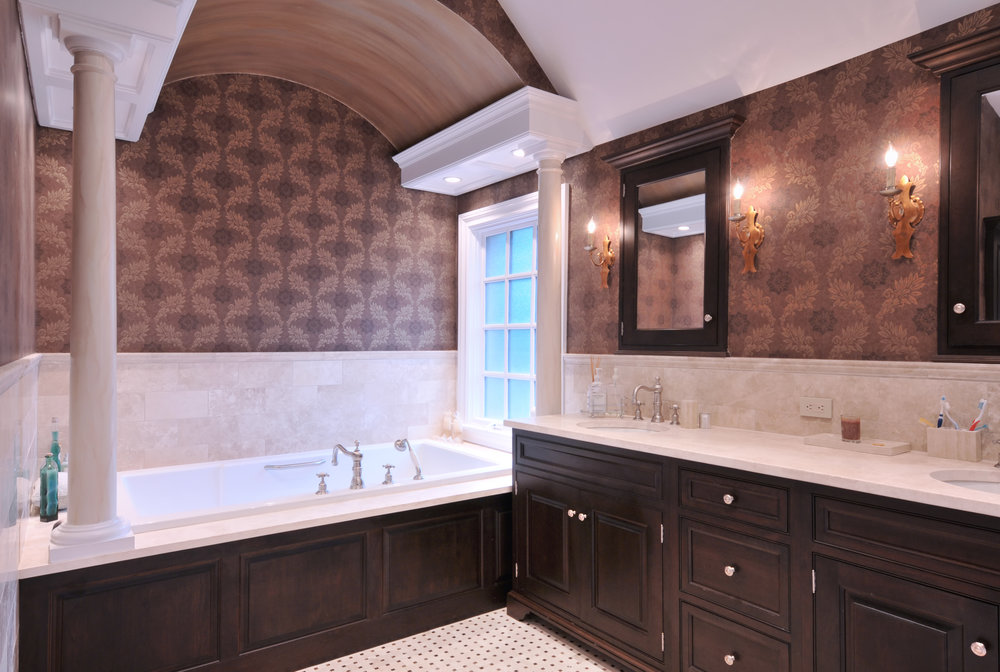 Traditional style bathroom with pillar and geometrically shaped decorative tiled wall