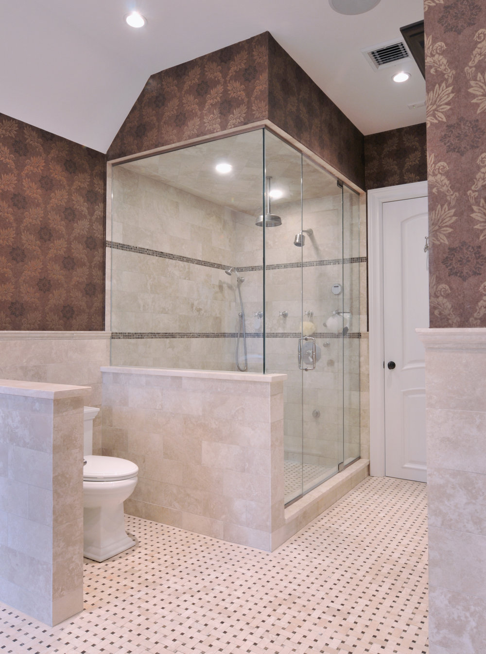 Traditional style bathroom with glass walled shower