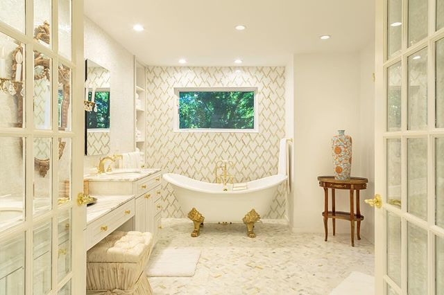 Talk about a gold rush Products used:  Calcutta gold marble  Mother of pearl mossaic tile  White thasos