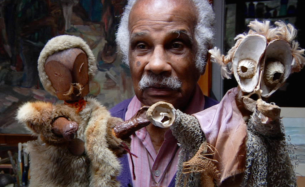 Ashley Bryan with his puppets Babatu and Osaze made from found objects
