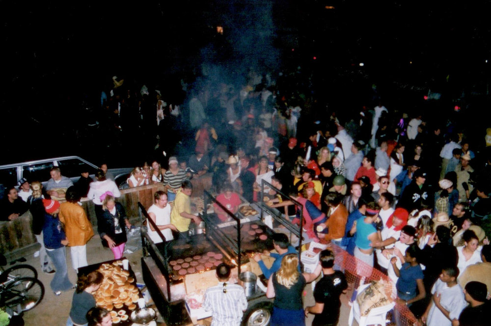 A photo from 2002 of the very first Jesus Burgers at the house on Del Playa, on Halloween night.