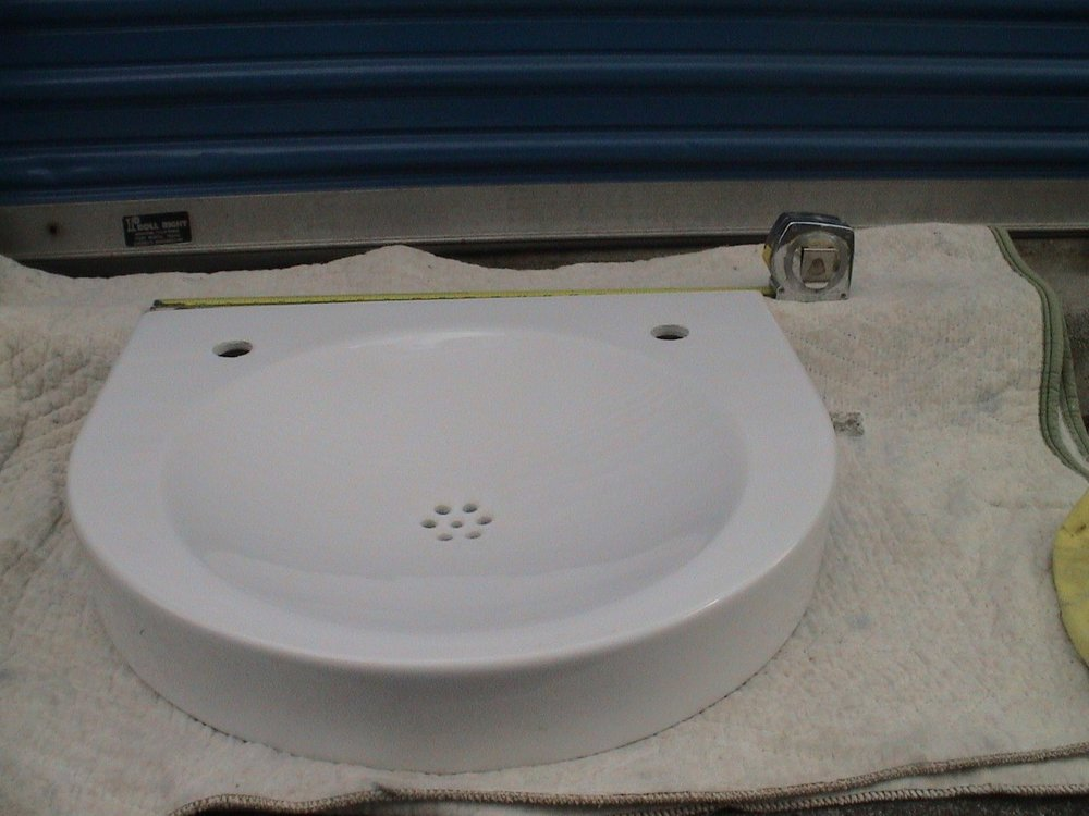 Architect's ADA 2h horseshoe basin, 57,5 w x 52 deep x 10.5cm high, White Ceramic. note hole punch for faucet and soap R and L.jpg