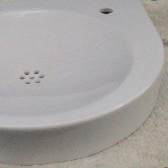 Architect's ADA 2h horseshoe basin, 57,5 w x 52 deep x 10.5cm high, White Ceramic. note hole punch for faucet and soap R and L C.jpg