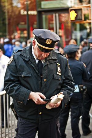 Policeman with cellphone