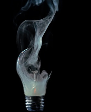 Broken smoking lightbulb