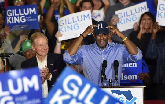 Florida Gubernatorial Democratic candidate Andrew Gillum puts on his FL ball cap as Senator Bill Nelson looks on during a rally Monday, Oct. 22, 2018 in the Field House at the University of North Florida in Jacksonville, Fla. (Bob Self/Florida Times-Union via AP) ORG XMIT: FLJAJ101   (Photo: Bob Self, AP)