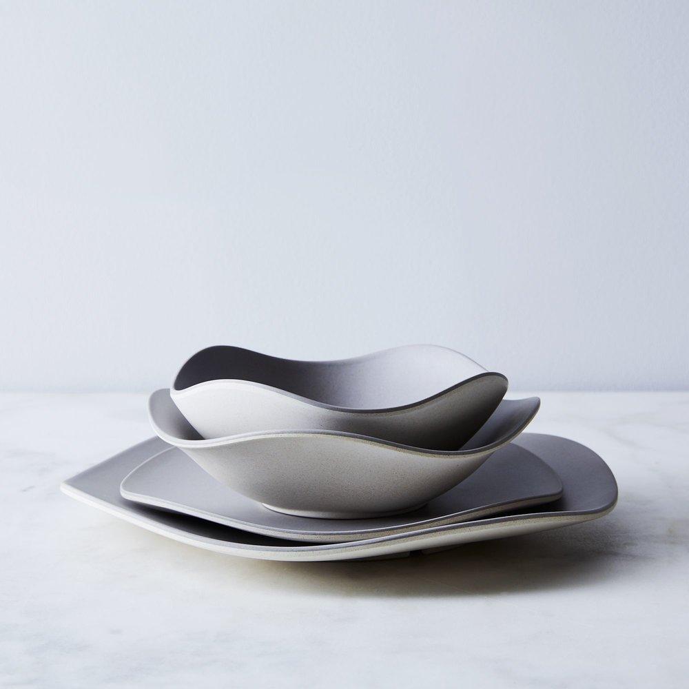 3403324a-7967-4dc1-9224-bcebe1d74b7a--2018-0227_bamboozle_curved-bamboo-dinnerware-set-of-4_family_silo_ty-mecham_003.jpg