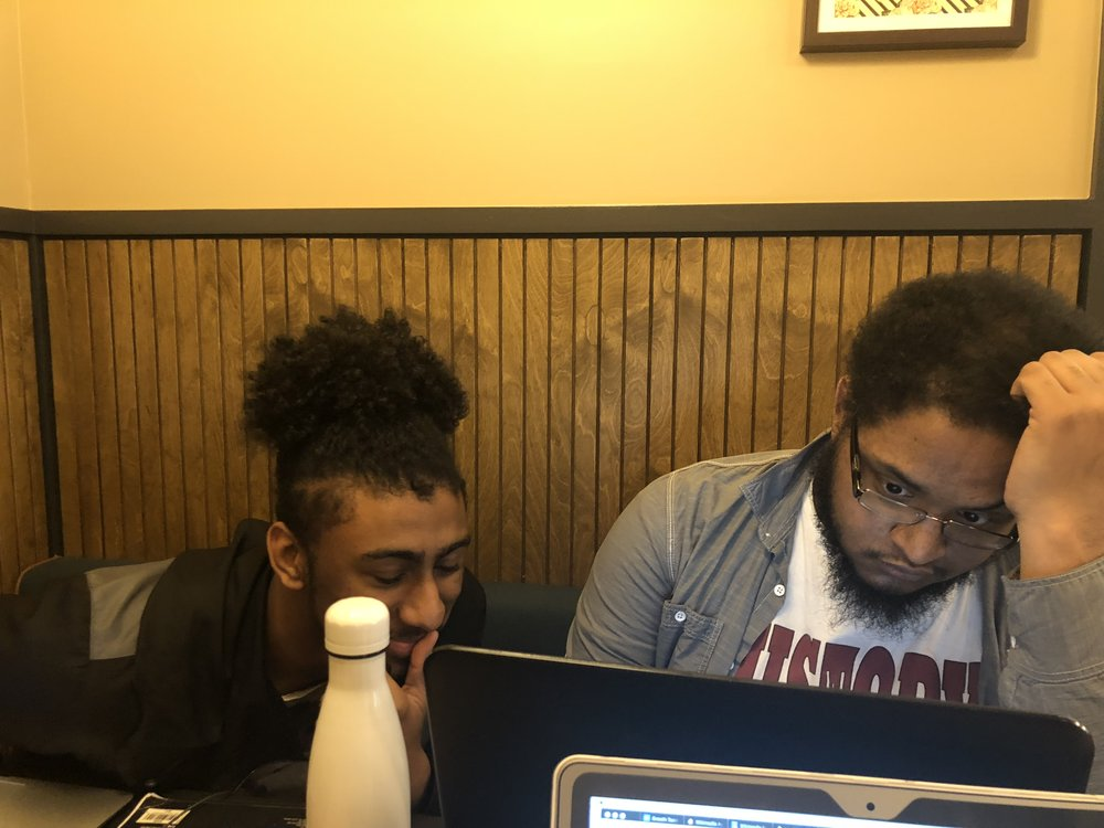 Project Lead, Michael Christian Boodoo working with Youth Technologist Rufus Denmon-Pena on Wiki Education bug fixes.