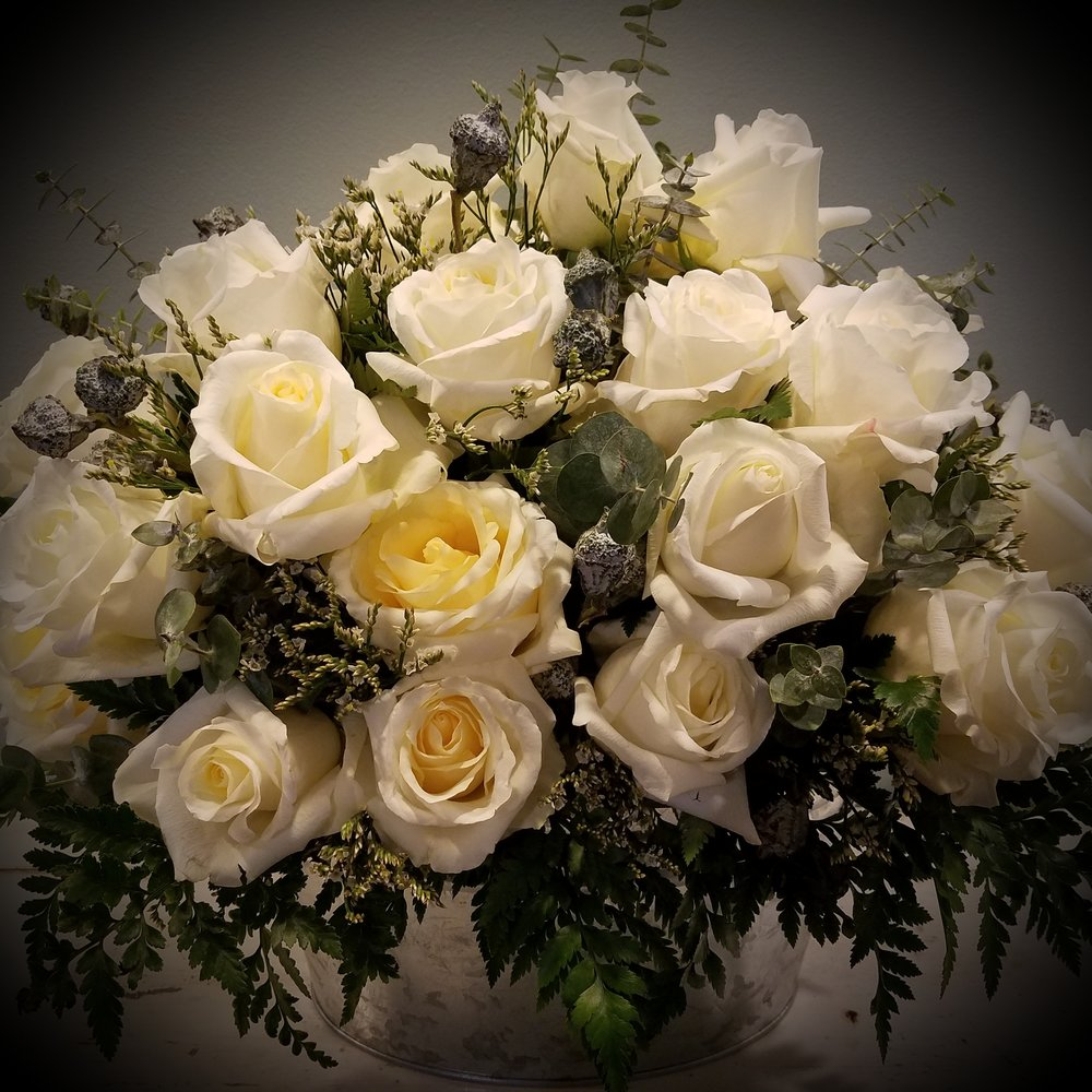White roses sympathy arrangement