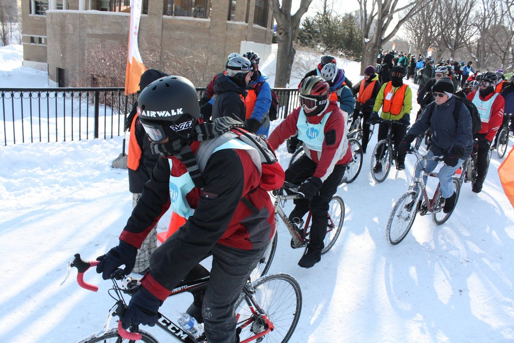 Cyclists pedal at the starting line of the Velo Sous Zero event in Parc Lafontaine on February 15, 2015. The annual bike circuit brings winter cyclists together for a 14-km ride through Montreal in sub-zero temperatures.