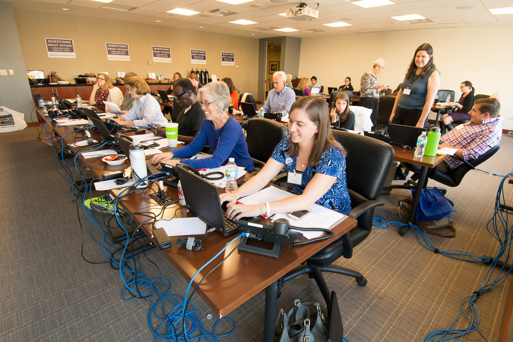 Attorneys and law students answer phones and log calls during the Nonpartisan Election Call Center at Brownstein Hyatt Farber Schreck, LLP in 2016.