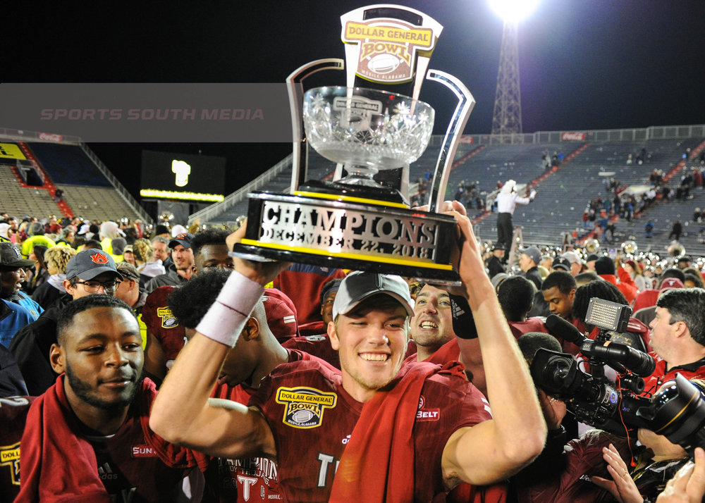 DEC 22; Dollar General Bowl: Troy defeats Buffalo, 42-32, to secure the championship title
