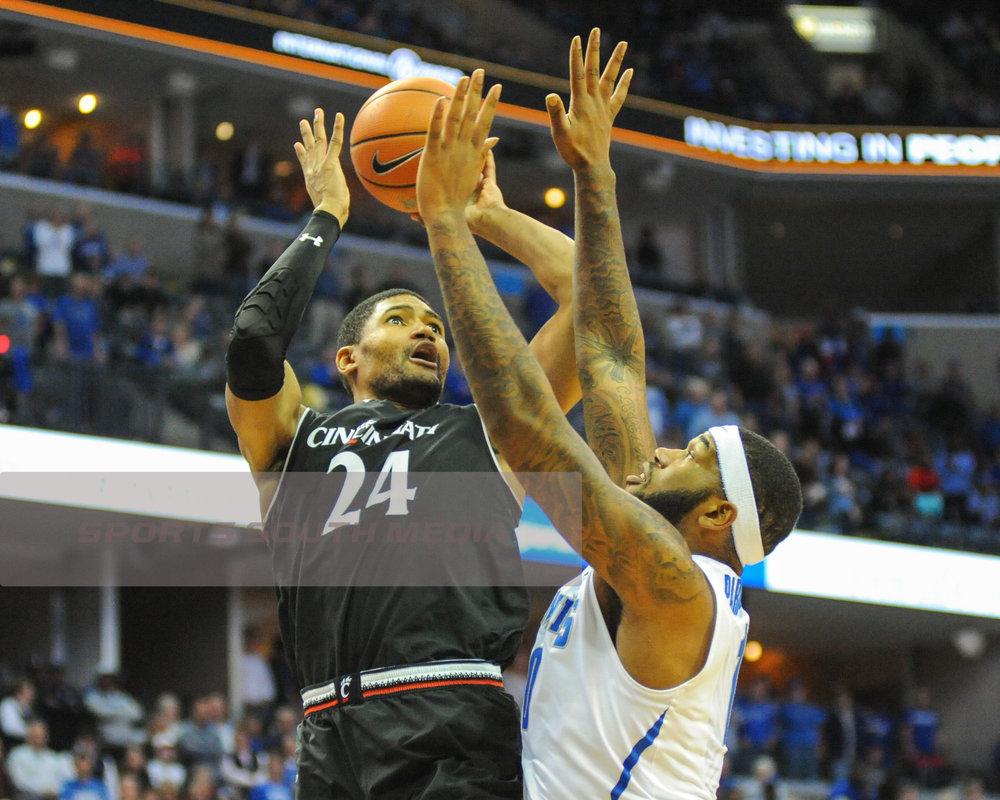 FEB 7; Cincinnati upsets Memphis, win 69-64
