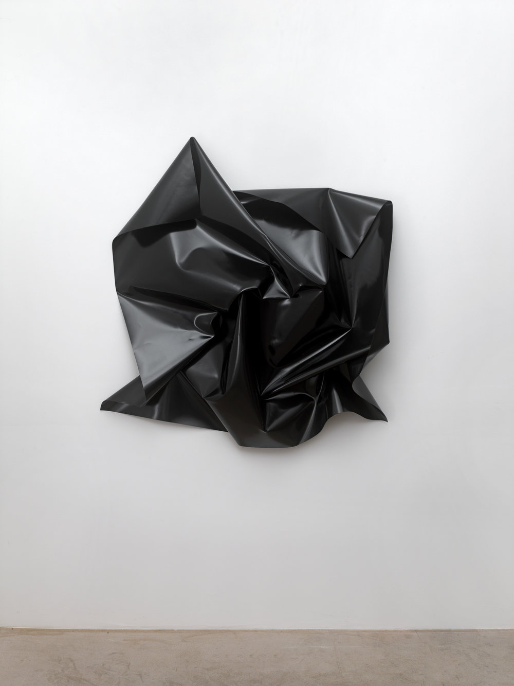 o.T., (untitled), 2013  PVC-tarpaulin (black), 4 brass screw closures, ca. 135 x 135 x 32 cm, dimensions of the tarpaulin: 150 x 150 cm