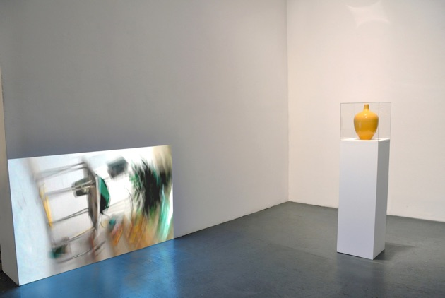 Production, 2011  Vase, Plinth, Perspex, Video projection with sound, headphones; Dims.: Variable.   Video duration: 12 mins looped