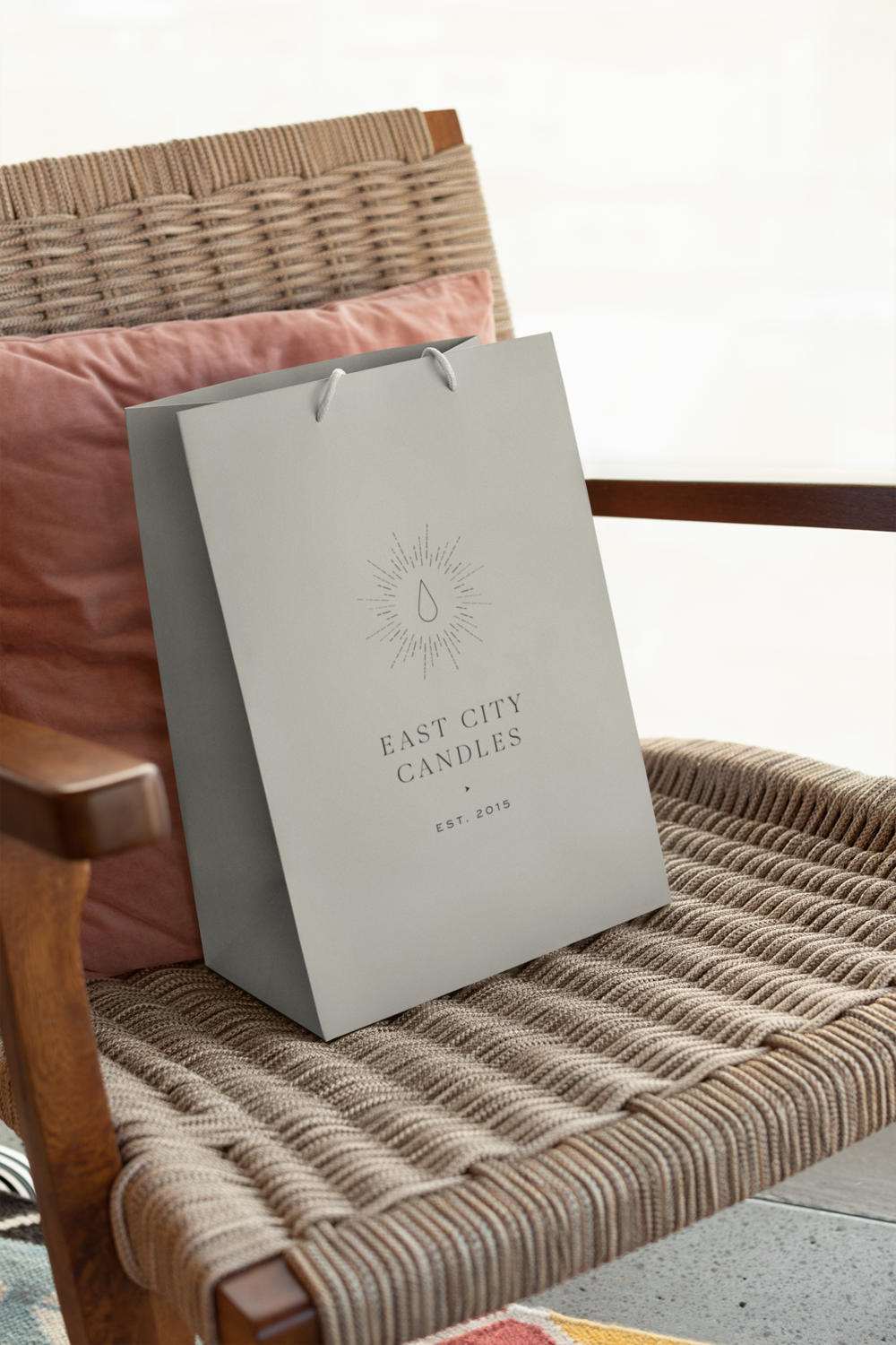 mockup-of-a-gift-bag-placed-upon-a-weaved-chair-24035.png