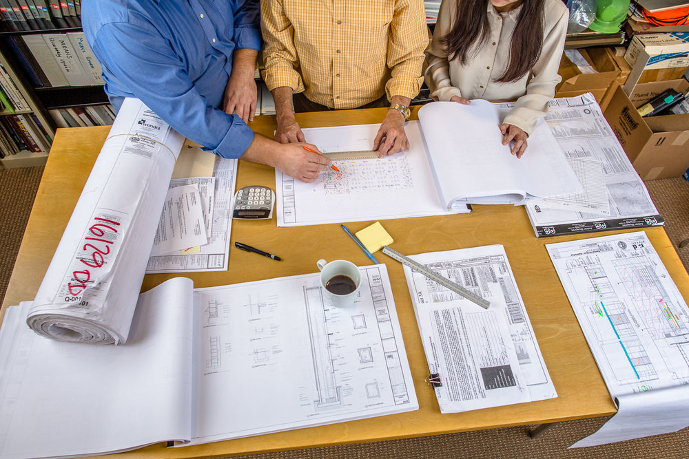 Architects-At-Work-with-Blueprints-Erik-Meadows