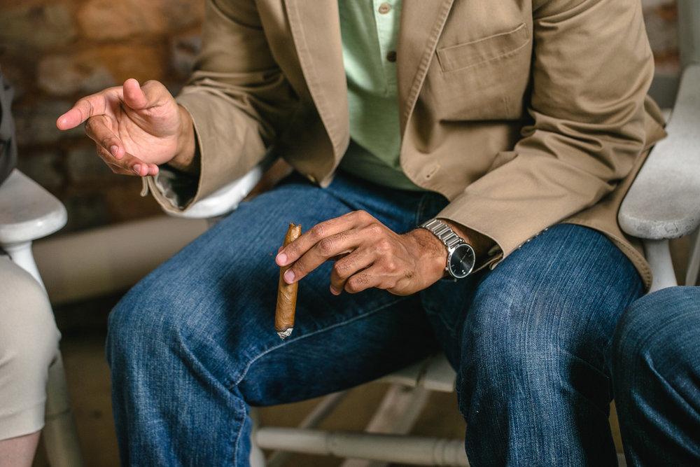 Man-Smokes-Cigar-Erik-Meadows