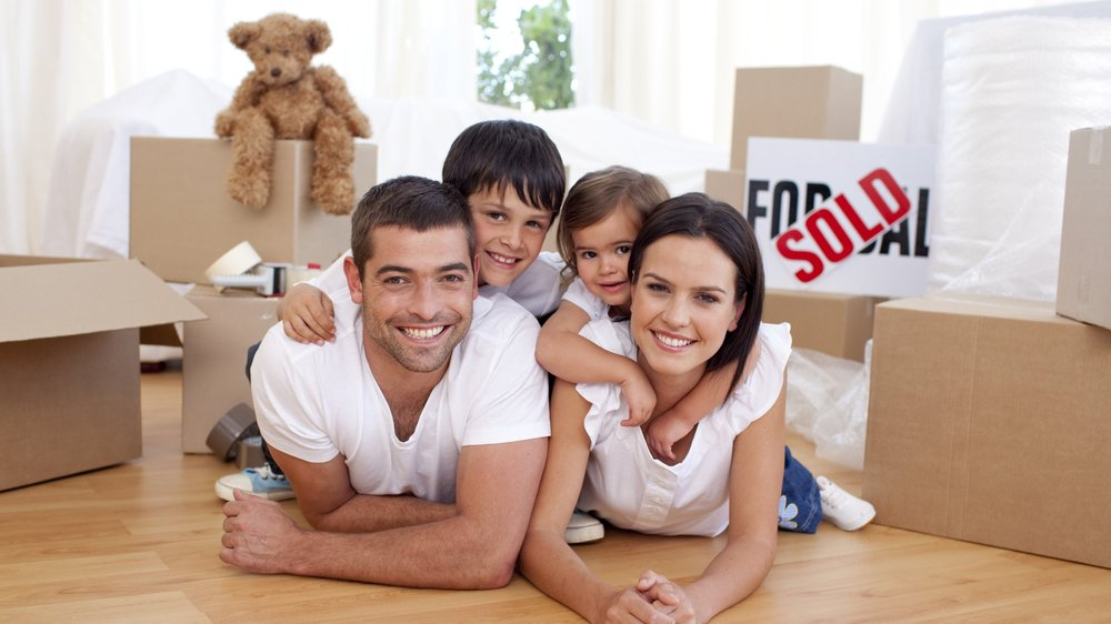 bigstock-Happy-Family-After-Buying-New--6181243.jpg