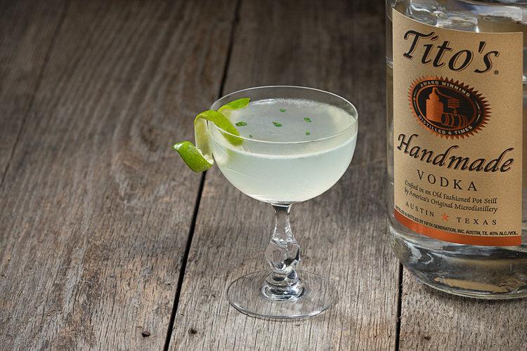 Basil gimlet cocktail made using Tito's Handmade Vodka
