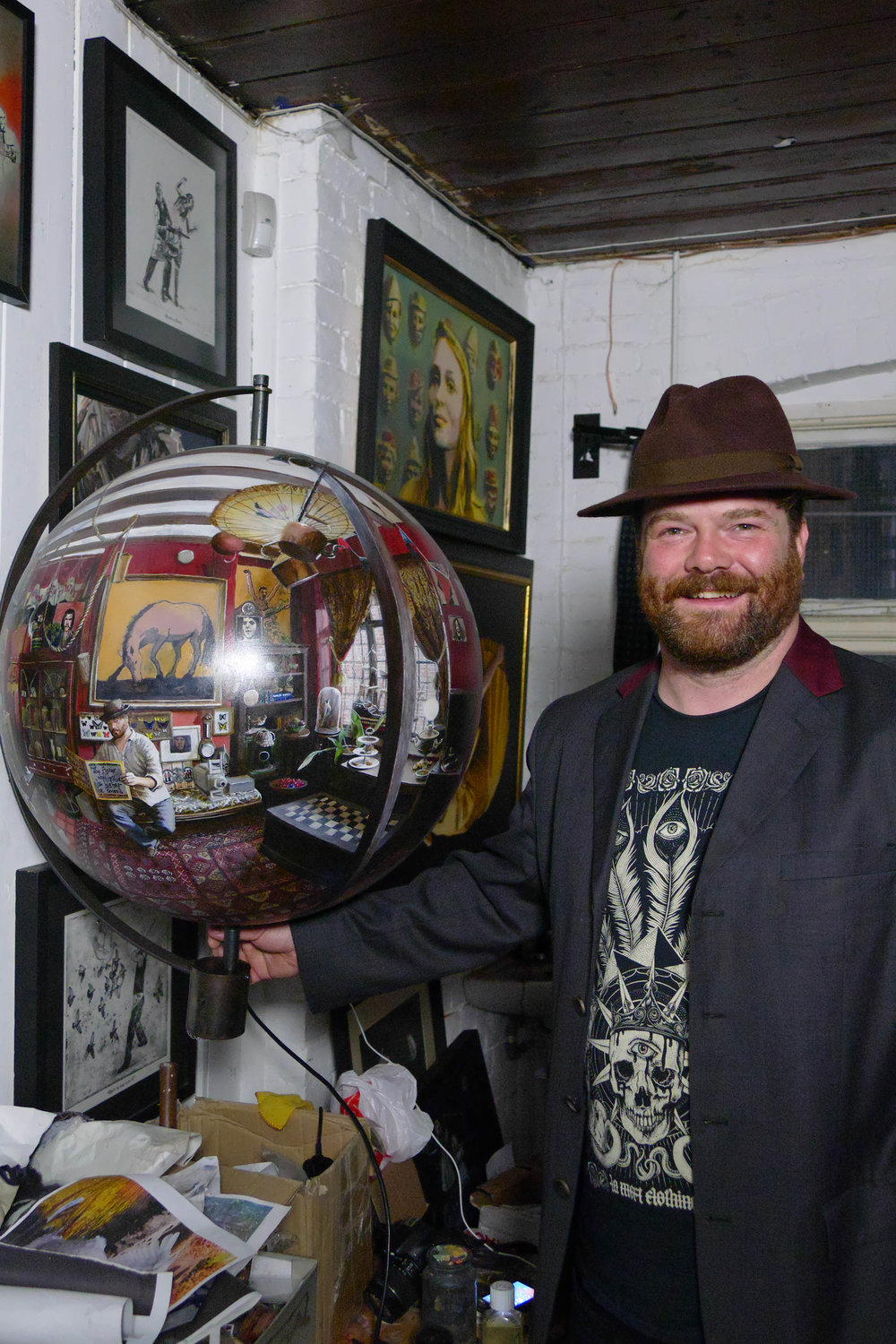 Will Teather with a painted sphere in his studio at Muspole Workshops, Norwich.jpg