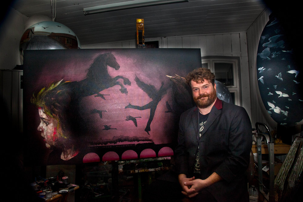 Will Teather with a recent painting in his studio at Muspole Workshops, Norwich.jpg