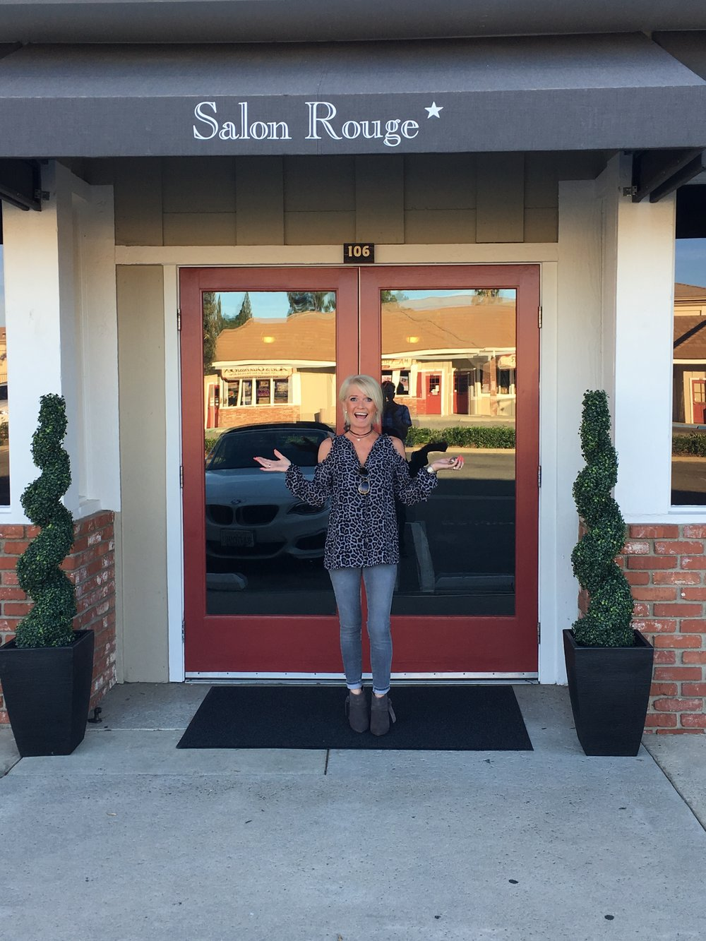 Jules Owen poses outside of the Salon Rouge front doors the first day in business as the new owner.   November 1st, 2018