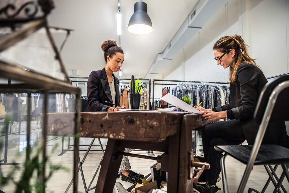 New-Business-clothing-store,-women-at-work-on-contracts-509724030_5616x3744.jpeg