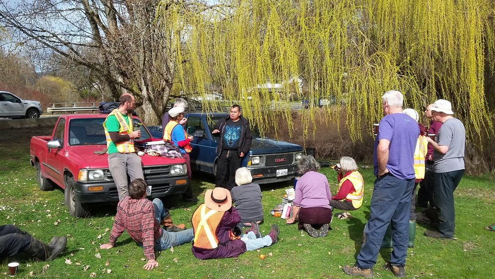Learning from Cowichan Elder Doug August at coffee break of planting event at Somenos Creek - Photo by Elizabeth Aitken