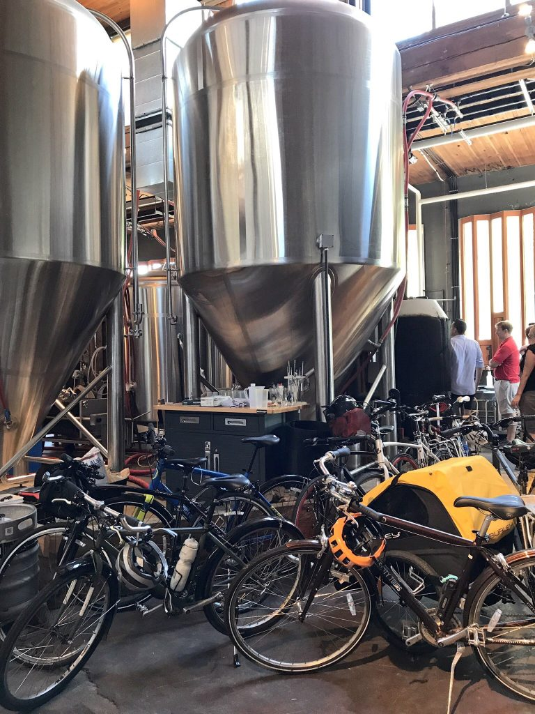 Famous Relentless & City Cycle Vancouver Craft Beer Tour – First Stop Postmark Brewing – Behind the Scenes and Vats.