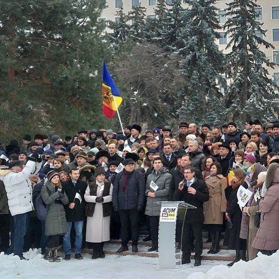 The ACUM electoral bloc holds a rally outside of the Moldovan parliament building.
