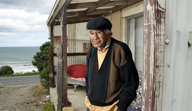 """""""BY THE SEASIDE: Hone Tuwhare at his Kaka Point crib in South Otago, South Island, New Zealand, which his family hopes will become the first Maori writers' residence"""" (McCammon, 2011). Source:  Stuff.co.nz"""