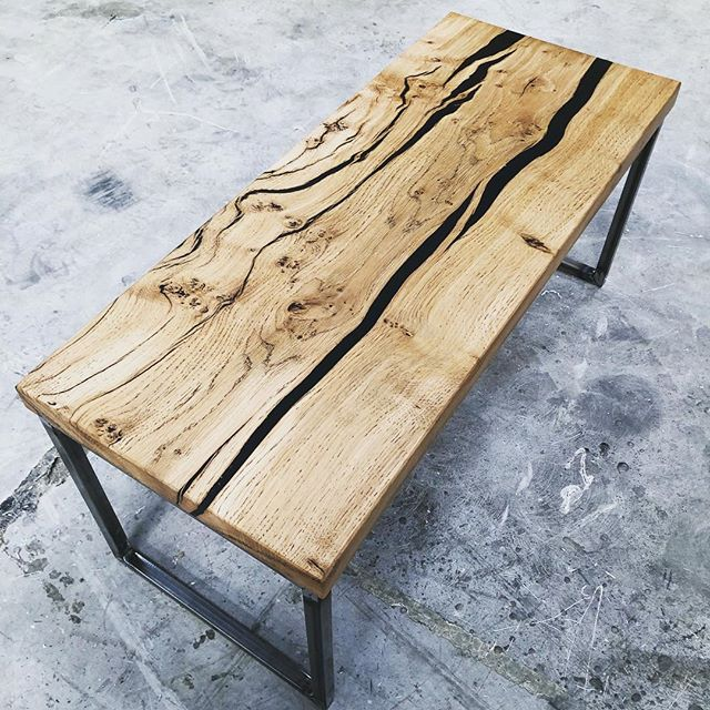 Solid oak black resin infill coffee table Supported with a steel frame. #oak #resin #resinwood #resintable #steel #coffeetable #feature #blackresin #black