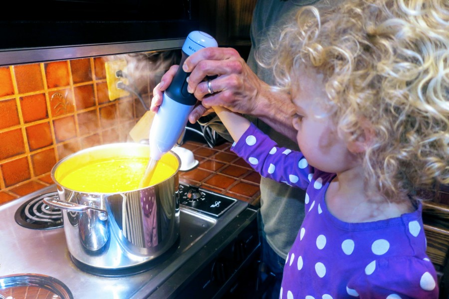 Ellie helping to make west african peanut soup, a staple in our house