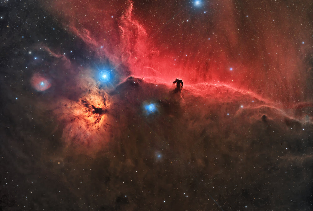 NGC 2023 - Horsehead and Flame Nebulae    Image by    Andy Chatman     The Horsehead and Flame Nebulae region in the constellation Orion. The horse head shape is silhouetted against a backdrop of illuminated hydrogen gas.  This image was taken from Samphran, Thailand, using a 300mm F3.0 telescope, and is the result of approximately 39 hours taken through L, R, G, B, Hydrogen-alpha and Sulfur 2 filters. Imaged and processed in Samphran, Thailand by the SC Observatory team: Mike Selby, Stefan Schmidt and Andy Chatman.