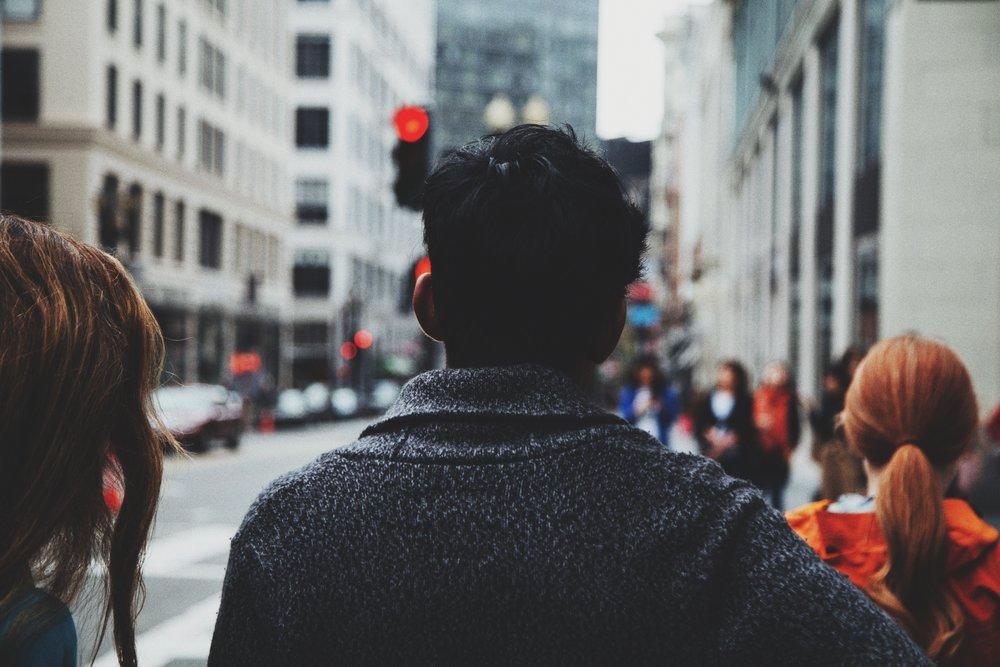 A man walking through the city alone.