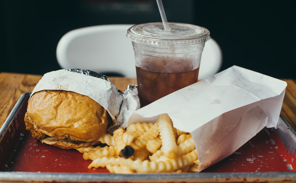 Unhealthy, fried fast food and a coke.