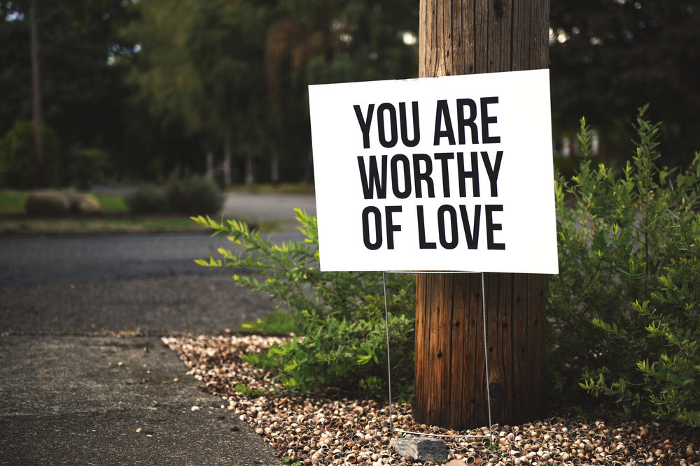 """A sign that says, """"You are worthy of love."""""""