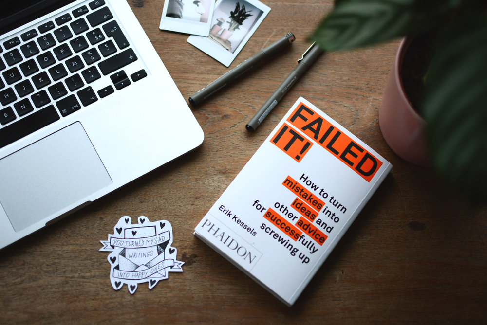 "A book on a desk that says ""failed it."""