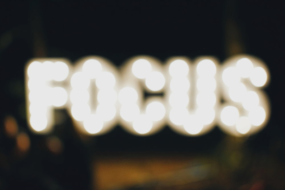 "Lights that say ""focus"" in front of a blurry background."